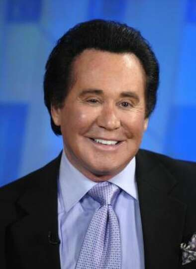 Wayne Newton looks plain comical now.