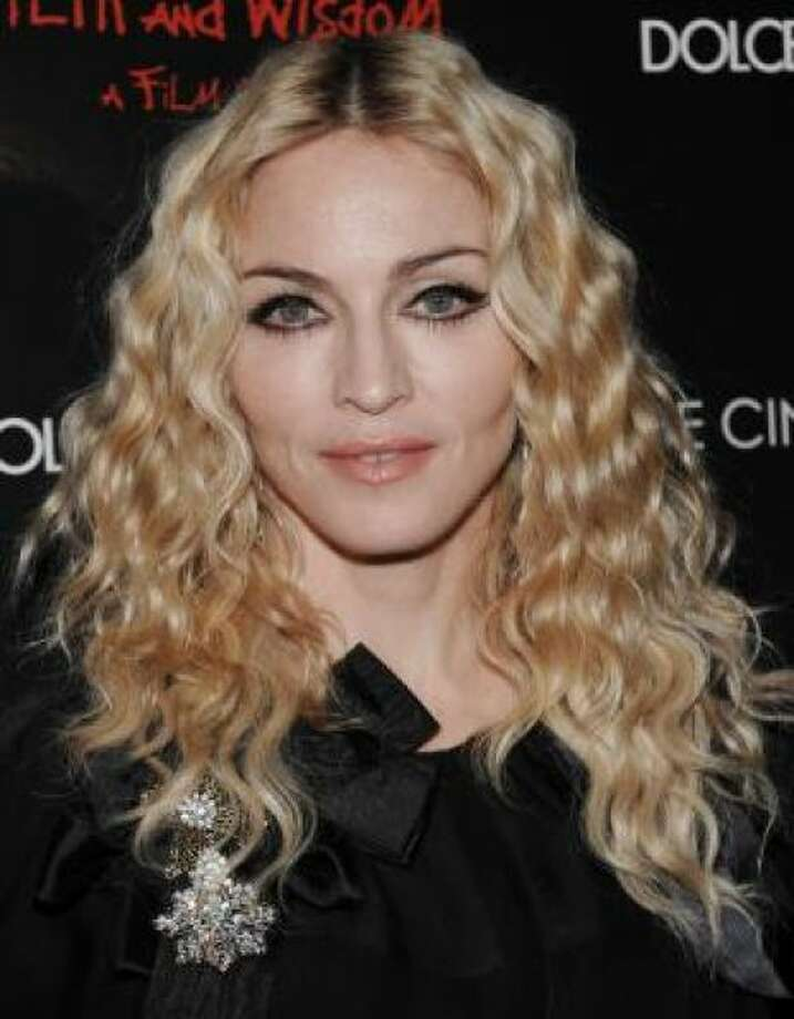 Madonna won't own up to doing anything to her face, but she has definitely done something to it. Photo: AP