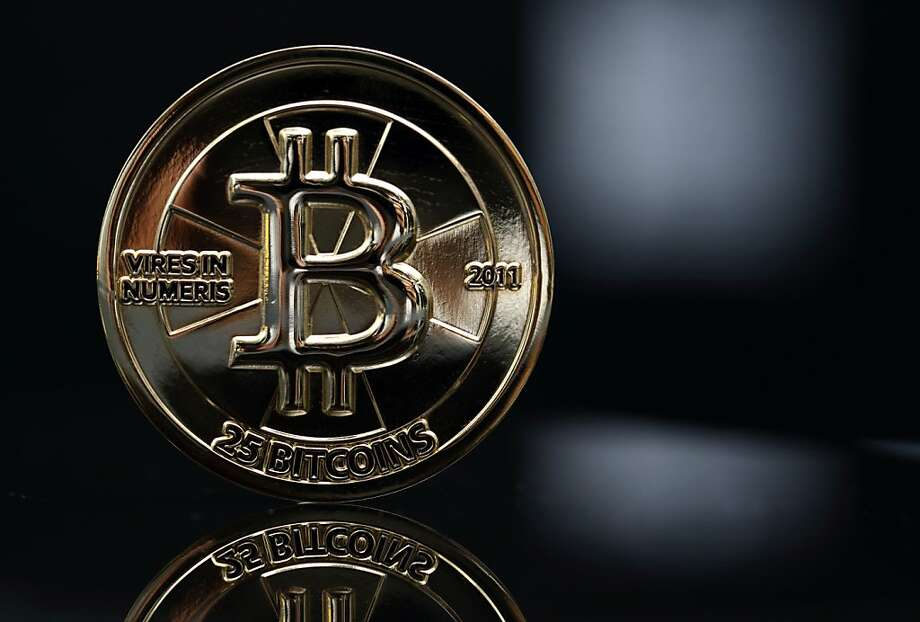 Bitcoin is a virtual currency that continues to gain acceptance from merchants and regulators. Photo: Tomohiro Ohsumi, Bloomberg