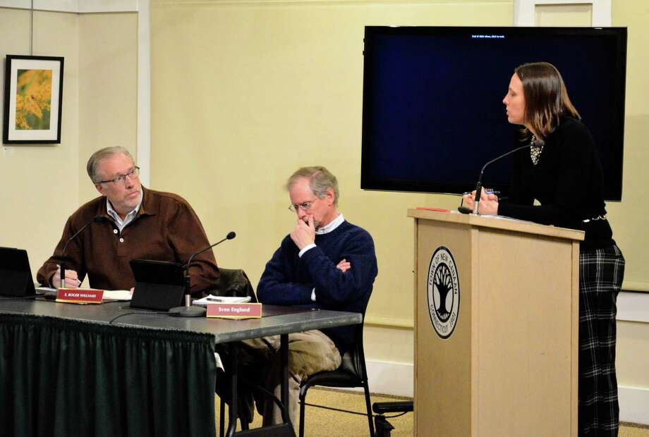 Town Council members E. Roger Williams and Sven Englund and Budget Director Jennifer Charneski talk about a proposed capital budgeting process during the council's meeting on Wednesday, Dec. 11, 2013, at the Nature Center in New Canaan, Conn. Photo: Nelson Oliveira / New Canaan News