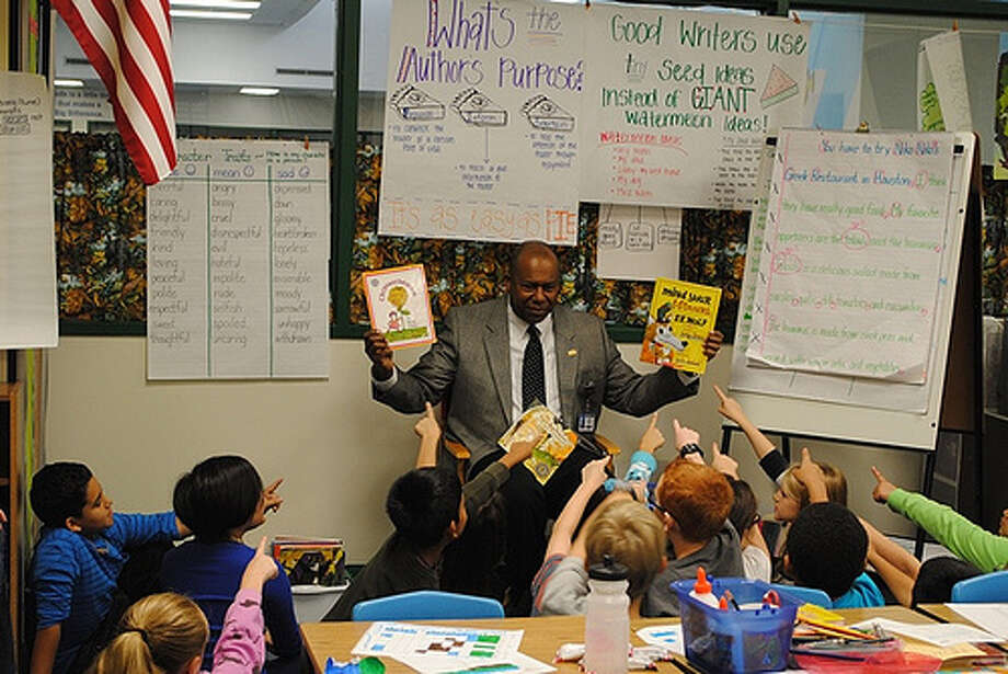 Volunteers read to an elementary classroom as part of the Promise to Read program. Photo: Katy Independent School District