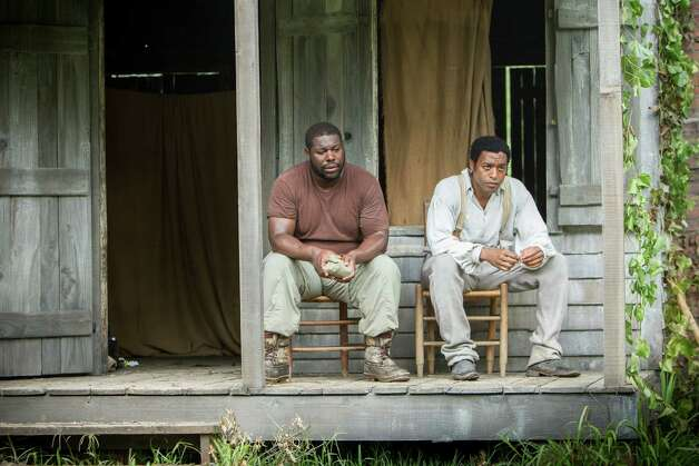 "This image released by Fox Searchlight shows director Steve McQueen, left, and actor Chiwetel Ejiofor during the filming of ""12 Years A Slave."" McQueen was nominated for a Golden Globe for best director for the film on Thursday, Dec. 12, 2013.  The 71st annual Golden Globes will air on Sunday, Jan. 12. (AP Photo/Fox Searchlight, Jaap Buitendijk) ORG XMIT: NYET806 Photo: Jaap Buitendijk / Fox Searchlight"