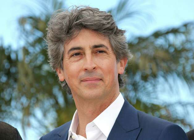 "FILE - This May 23, 2013 file photo shows director Alexander Payne during a photo call for the film ""Nebraska"" at the 66th international film festival, in Cannes, southern France.  Payne was nominated for a Golden Globe for best director  for the film on Thursday, Dec. 12, 2013.  The 71st annual Golden Globes will air on Sunday, Jan. 12. (AP Photo/Lionel Cironneau) ORG XMIT: NYET804 Photo: Lionel Cironneau / AP"