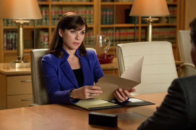 "This image released by CBS shows Julianna Margulies as Alicia Florrick in a scene from ""The Good Wife."" Margulies was nominated for a Golden Globe for best actress in a drama series for her role in the series on Thursday, Dec. 12, 2013.  The 71st annual Golden Globes will air on Sunday, Jan. 12. (AP Photo/CBS, David Giesbrecht) ORG XMIT: NYET802 Photo: David Giesbrecht / CBS ENTERTAINMENT"