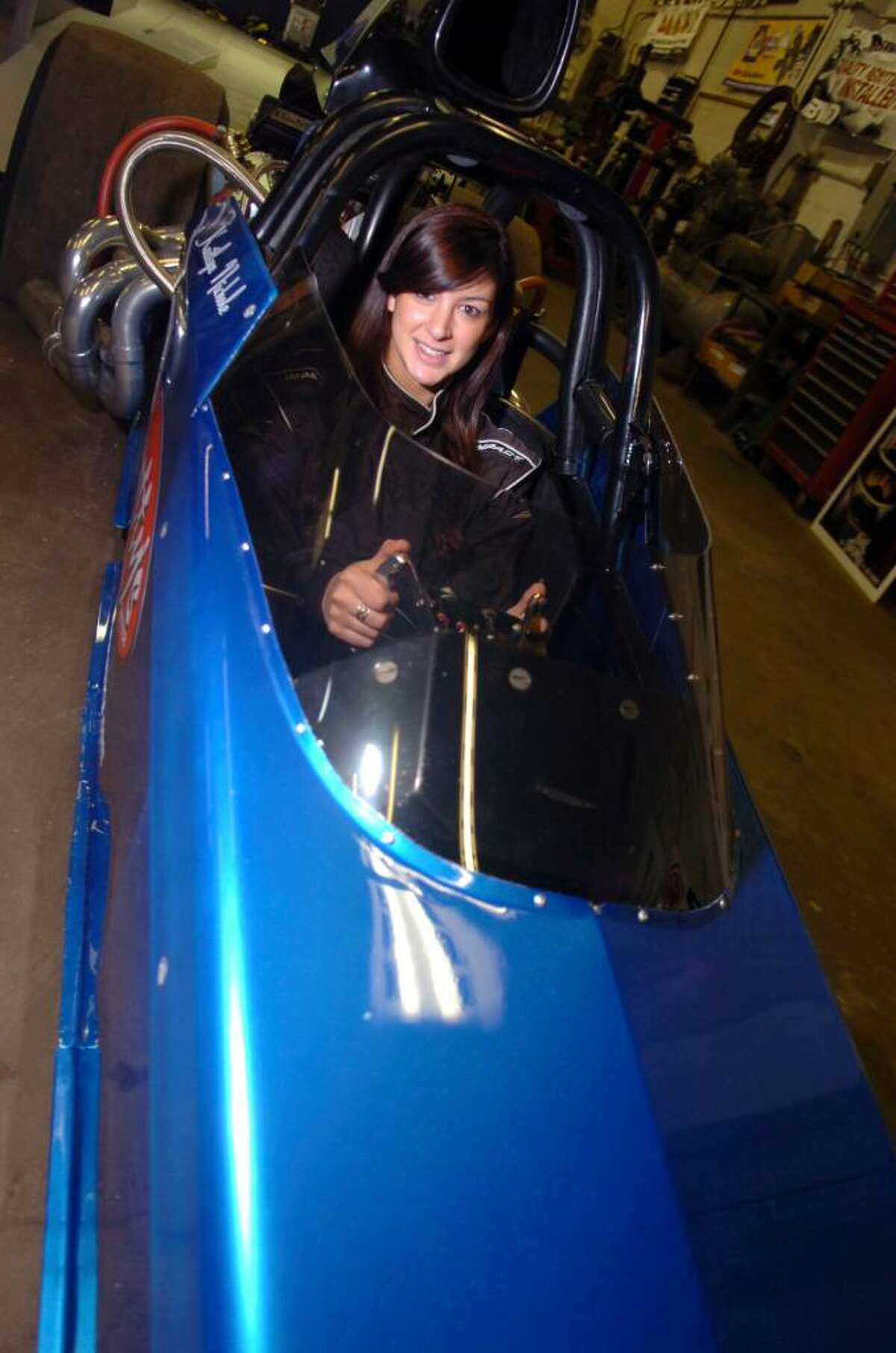 Kaitlyn Sobeski, a 24-year-old Greenwich High School graduate and former cheerleader, who is now learning to race a rear-engine dragster in Florida. She sits in the dragster, on January 24, 2010, in her father, Scotty Sobeski's, garage. Her first race will be in March.