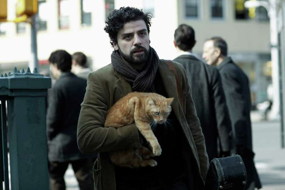 "This film image released by CBS FIlms shows Oscar Isaac in a scene from ""Inside Llewyn Davis."" Isaac was nominated for a Golden Globe for best actor in a motion picture musical or comedy for his role in the film on Thursday, Dec. 12, 2013.  The 71st annual Golden Globes will air on Sunday, Jan. 12. (AP Photo/CBS FIlms, Alison Rosa) ORG XMIT: NYET749 Photo: Alison Rosa / CBS FIlms"