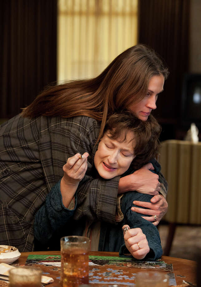 """This publicity image released by The Weinstein Company shows, from left, Julia Roberts and Meryl Streep in a scene from """"August: Osage County."""" Streep was nominated for a Golden Globe for best actress in a motion picture musical or comedy for her role in the film on Thursday, Dec. 12, 2013.  The 71st annual Golden Globes will air on Sunday, Jan. 12. (AP Photo/The Weinstein Company, Claire Folger) ORG XMIT: NYET744 Photo: Claire Folger / The Weinstein Company"""