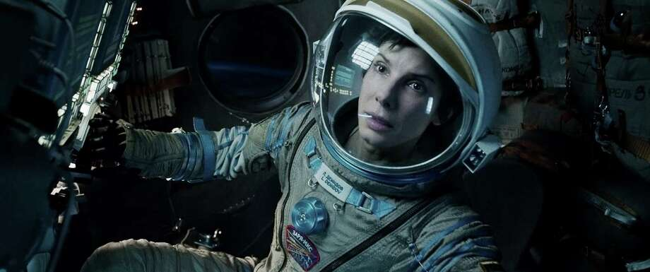 """This film image released by Warner Bros. Pictures shows Sandra Bullock in a scene from """"Gravity."""" The film was nominated for a Golden Globe for best motion picture drama on Thursday, Dec. 12, 2013.  The 71st annual Golden Globes will air on Sunday, Jan. 12. (AP Photo/Warner Bros. Pictures, File) ORG XMIT: NYET708 Photo: Uncredited / Warner Bros. Pictures"""