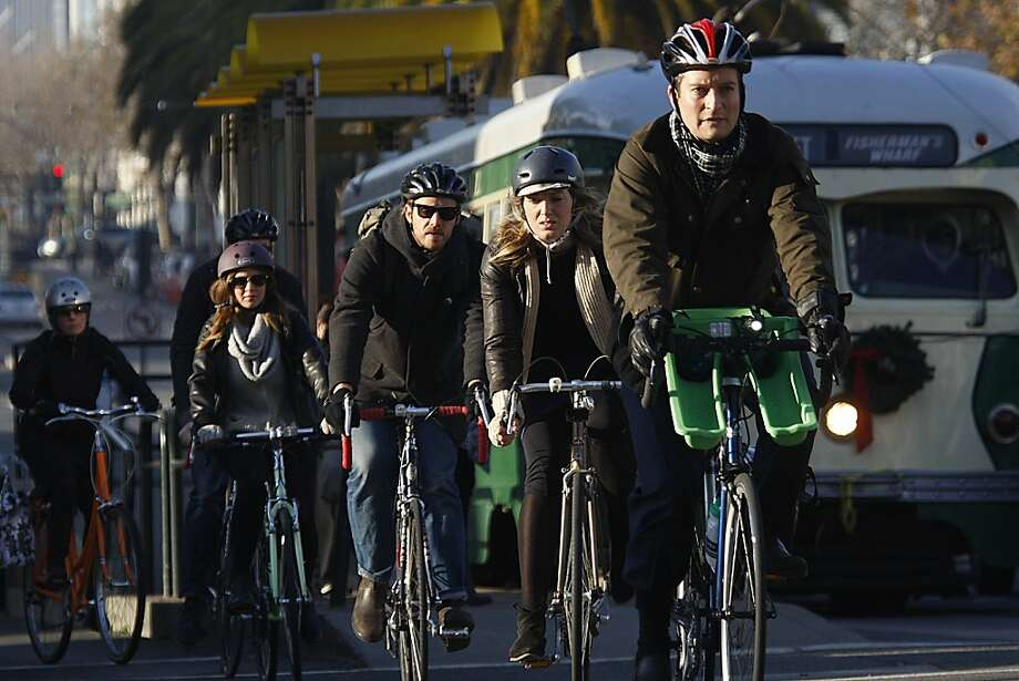 Bike commuters cruise along Market Street. Since 2006, San Francisco's bicycle traffic has increased by 96 percent. Photo: Liz Hafalia, Chronicle
