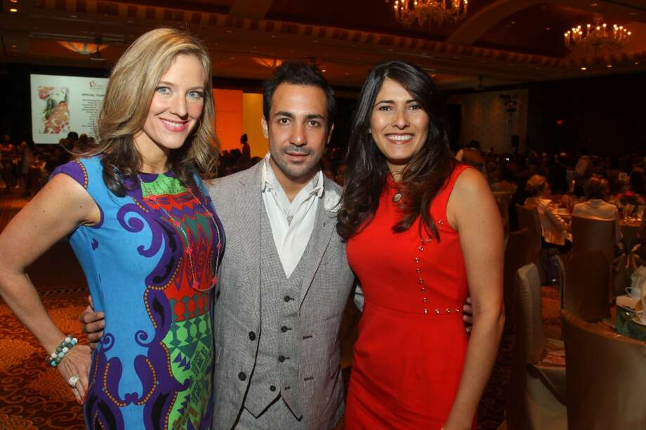 Sally Lechin, from left, designer Alejandro Carlin and Marianelly Noble at the Latin Women's Initiative luncheon and fashion show on May 3. Photo: Gary Fountain, For The Chronicle