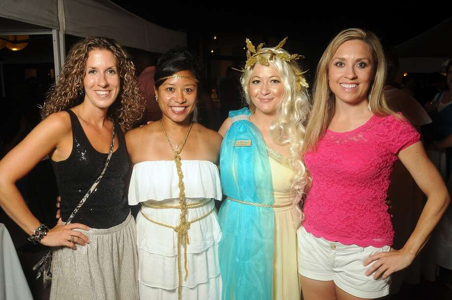 Lisa Ambro, Margaret Dieta, Cindy Rodriguez and Susan Tarantino at the Bering Omega toga party at the Craft Salon Saturday July 20. Photo: Dave Rossman, For The Houston Chronicle