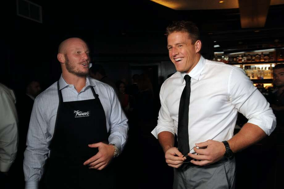 Houston Texans Chris Myers and J.J. Watt joke around at the Fourth Annual Celebrity Waiter Night hosted by Houston Texan Owen Daniels and benefitting the Owen Daniels Catching Dreams Foundation at Del Frisco's Double Eagle Steak House on Sept. 16. Photo: Dave Rossman, For The Houston Chronicle