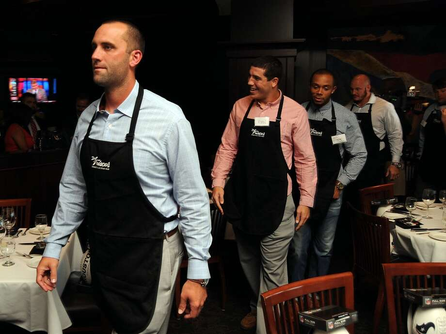 Matt Schaub and other Texan players prepare to work at the Fourth Annual Celebrity Waiter Night hosted by Houston Texan Owen Daniels and benefitting the Owen Daniels Catching Dreams Foundation at Del Frisco's Double Eagle Steak House on Sept. 16. Photo: Dave Rossman, For The Houston Chronicle