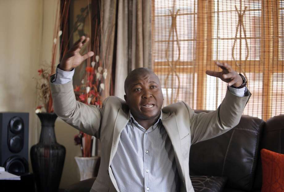 Thamsanqa Jantjie gesticulates at his home during an interview with the Associated Press in Johannesburg, South Africa,Thursday, Dec. 12, 2013. Jantjie, the man accused of faking sign interpretation next to world leaders at Nelson Mandela's memorial, told a local newspaper that he was hallucinating and hearing voices. (AP Photo/Tsvangirayi Mukwazhi) Photo: Tsvangirayi Mukwazhi, Associated Press