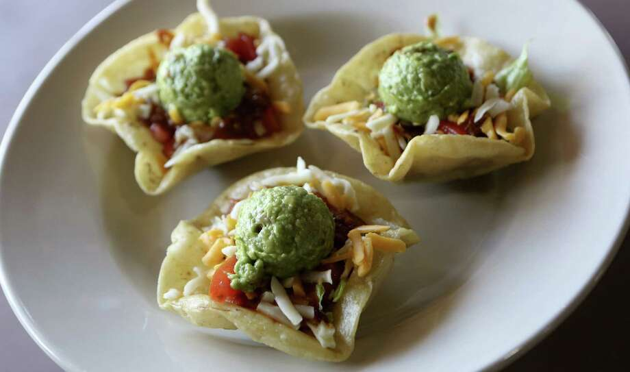 Freshly fried tortillas transform the Alamo Special Tacos into a highlight of a visit to Alamo Barbacoa. Photo: Photos By Helen L. Montoya / San Antonio Express-News / ©2013 San Antonio Express-News