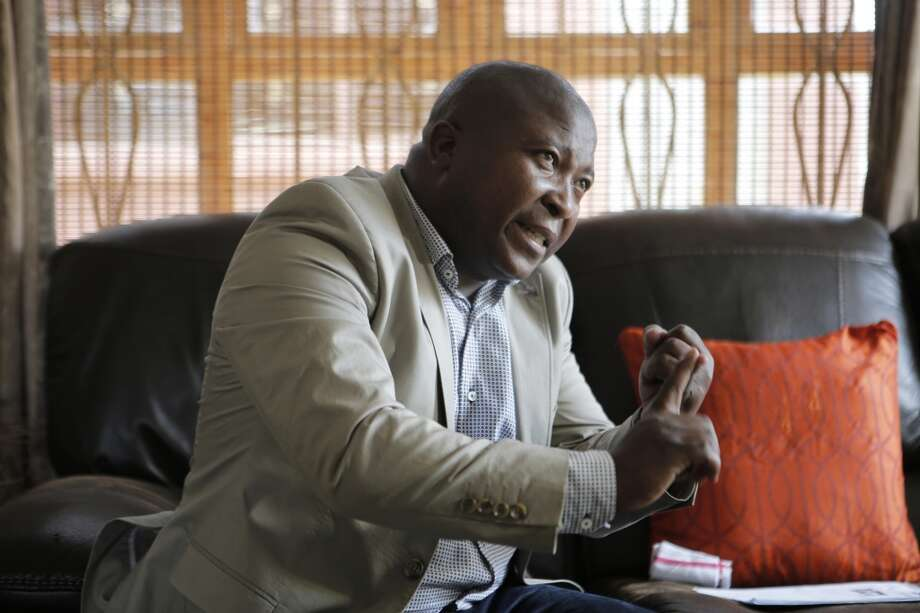 Thamsanqa Jantjie gestures at his home during an interview with the Associated Press in Johannesburg, South Africa,Thursday, Dec. 12, 2013. Jantjie, the man accused of faking sign interpretation next to world leaders at Nelson Mandela's memorial, told a local newspaper that he was hallucinating and hearing voices. (AP Photo/Tsvangirayi Mukwazhi) Photo: Tsvangirayi Mukwazhi, Associated Press