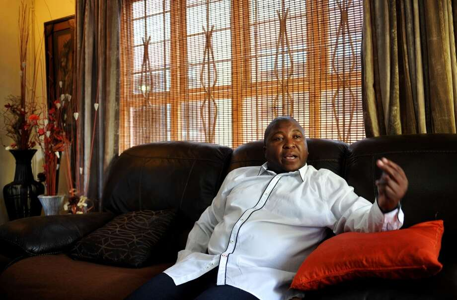 Sign language interpreter Thamsanqa Jantjie, who was interpreting at the memorial service of late former president Nelson Mandela speaks at his home in Bramfischerville, South Africa Wednesday Dec. 11, 2013. The man accused of faking sign interpretation next to world leaders at Nelson Mandela's memorial told a local newspaper that he was hallucinating and hearing voices. Thamsanqa Jantjie did describe his qualifications for being a sign language interpreter, but told The Star he works for an interpreting company that paid him $85 for interpreting Tuesday's event. He told Radio 702 Thursday he's receiving treatment for schizophrenia and had an episode while on stage. (AP Photo/Itumeleng English) SOUTH AFRICA OUT Photo: Itumeleng English, Associated Press