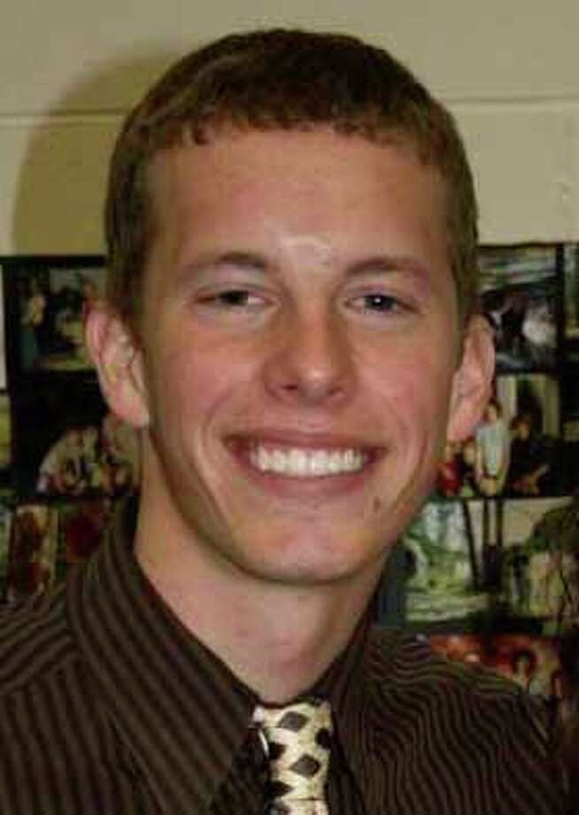 This undated photo provided by the Redus family shows Robert Cameron Redus, who was a student at the University of the Incarnate Word in San Antonio, Texas. Redus was killed last Friday, Dec. 6, 2013, shot five times by a campus police officer, who said Redus attacked him during a traffic stop and refused to back down, according to the authorities.  (AP Photo/Redus Family) Photo: Associated Press / Redus Family
