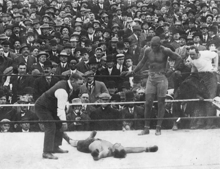Jack Johnson looks on as opponent Stan Ketchel is counted out on Oct. 16, 1909. Photo: Sporting News Archive, Sporting News Via Getty Images