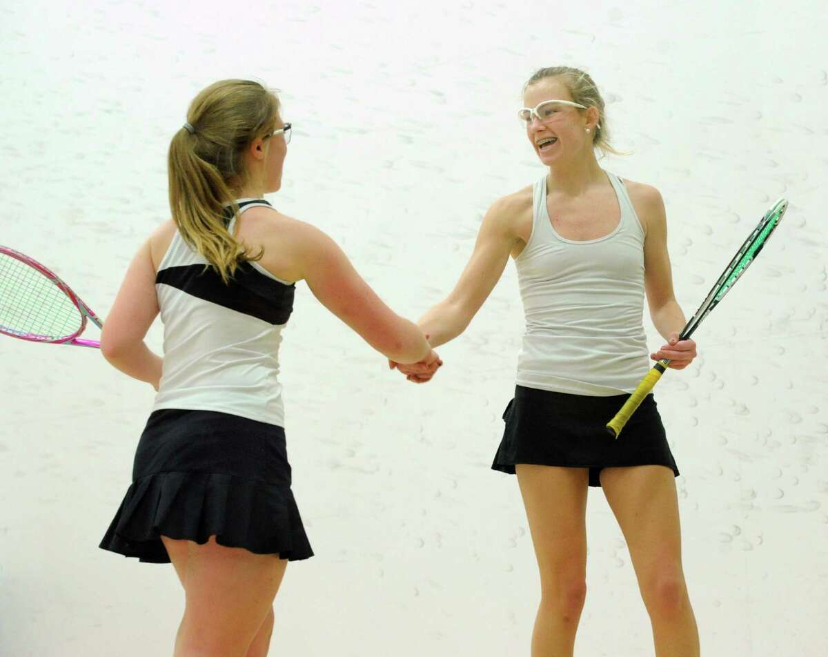 At left, Mary Grace Henry of Convent of the Sacred Heart shakes hands with Emme Leonard of Greenwich Academy, the winner of their match, during the high school squash match between Greenwich Academy and Convent of the Sacred Heart at Greenwich Academy, Thursday, Dec. 12, 2013.