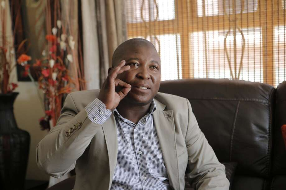 Thamsanqa Jantjie gestures at his home during an interview with the Associated Press in Johannesburg, South Africa, Thursday, Dec. 12, 2013. Jantjie, the man accused of faking sign interpretation next to world leaders at Nelson Mandela's memorial, told a local newspaper that he was hallucinating and hearing voices. (AP Photo/Tsvangirayi Mukwazhi) Photo: Tsvangirayi Mukwazhi, Associated Press