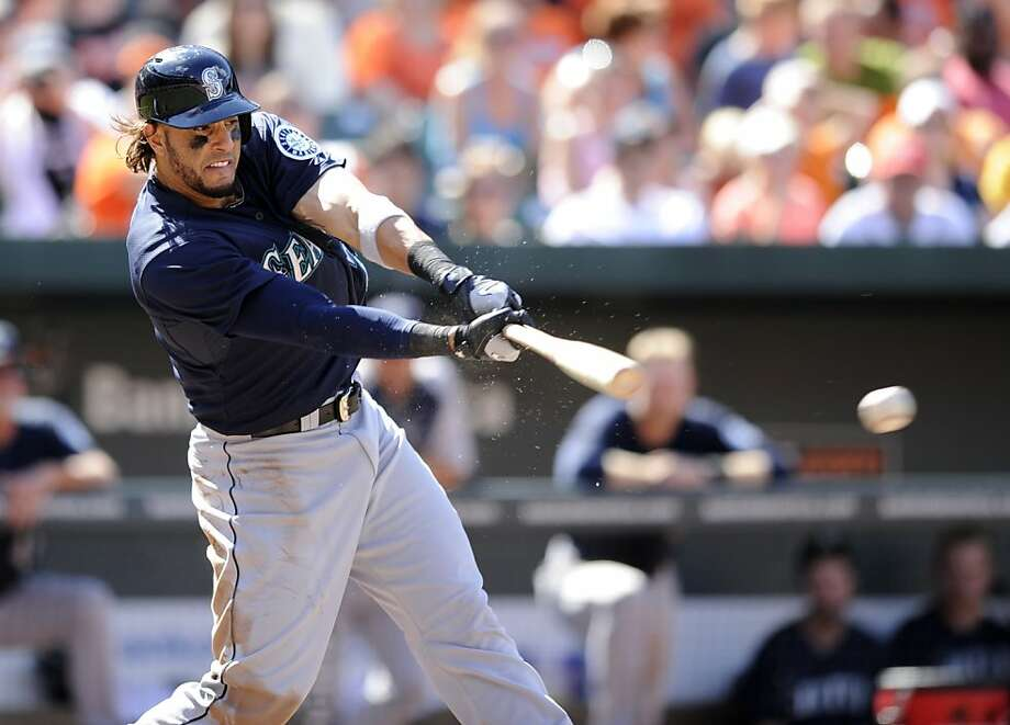 Seattle Mariners' Michael Morse bats during the eighth inning of a baseball game against the Baltimore Orioles, Sunday, Aug. 4, 2013, in Baltimore. The Mariners won 3-2. (AP Photo/Nick Wass) Photo: Nick Wass, Associated Press