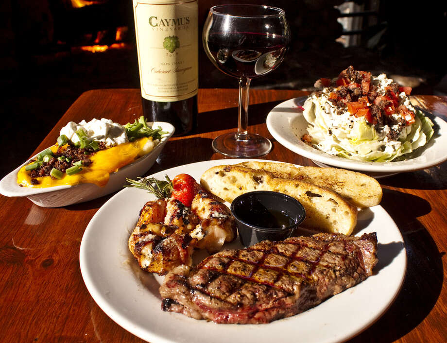 Steak, shrimp, mashed potatoes and wedge salad are on the New Year's Eve menu at Gristmill in Gruene. Photo: Courtesy Photo / Courtesy photo