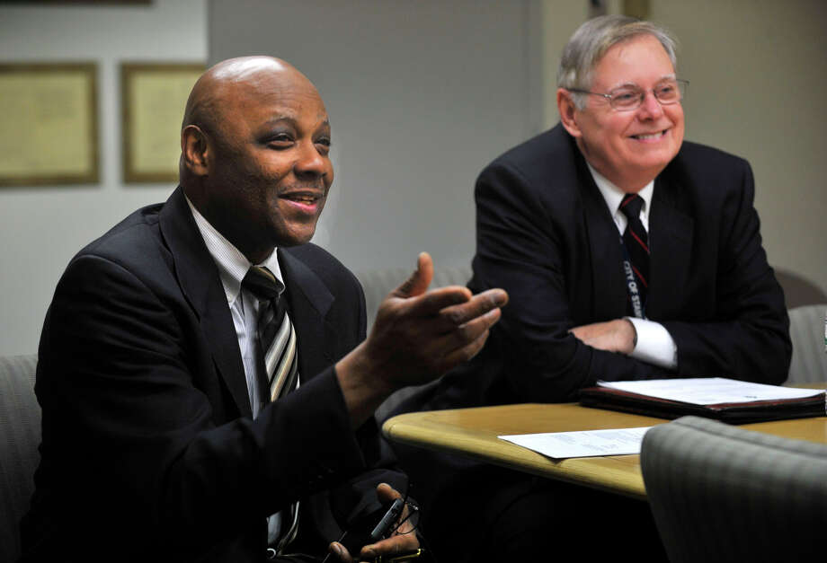 Mayor David Martin looks on as his appointed chief of staff Michale Pollard makes a comment before the new Board of Finance meeting at the Stamford Government Center in Stamford, Conn., on Thursday, Dec. 12, 2013. Photo: Jason Rearick / Stamford Advocate