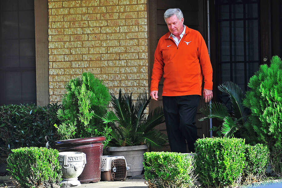 University of Texas head football coach Mack Brown walks outside of the residence of Ozen Panther high school football player Tony Brown after a recruiting visit on Thursday. Michael Rivera/@michaelrivera88