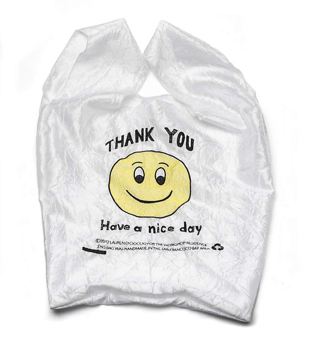 STOCKING STUFFERS: Have a nice day Smiley face Thank You bag usually found in plastic, redesigned by Lauren DiCioccio in fabric and made in San Francisco, $25, The Workshop Residence, www.theworkshopresidence.com.