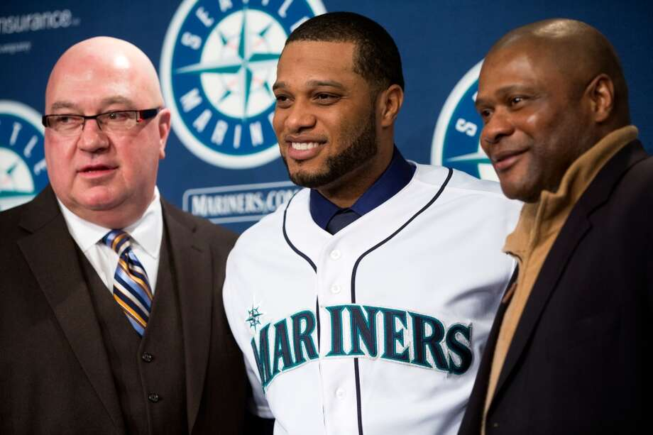 New Mariners second baseman Robinson Cano, center, poses for pictures with Mariners manager Lloyd  McClendon, right, and general manager Jack Zduriencik, left, on Thursday, Dec. 12, 2013, at Safeco Field in Seattle. Cano is the biggest free-agent signing in the team's history. (Jordan Stead, seattlepi.com) Photo: JORDAN STEAD, SEATTLEPI.COM