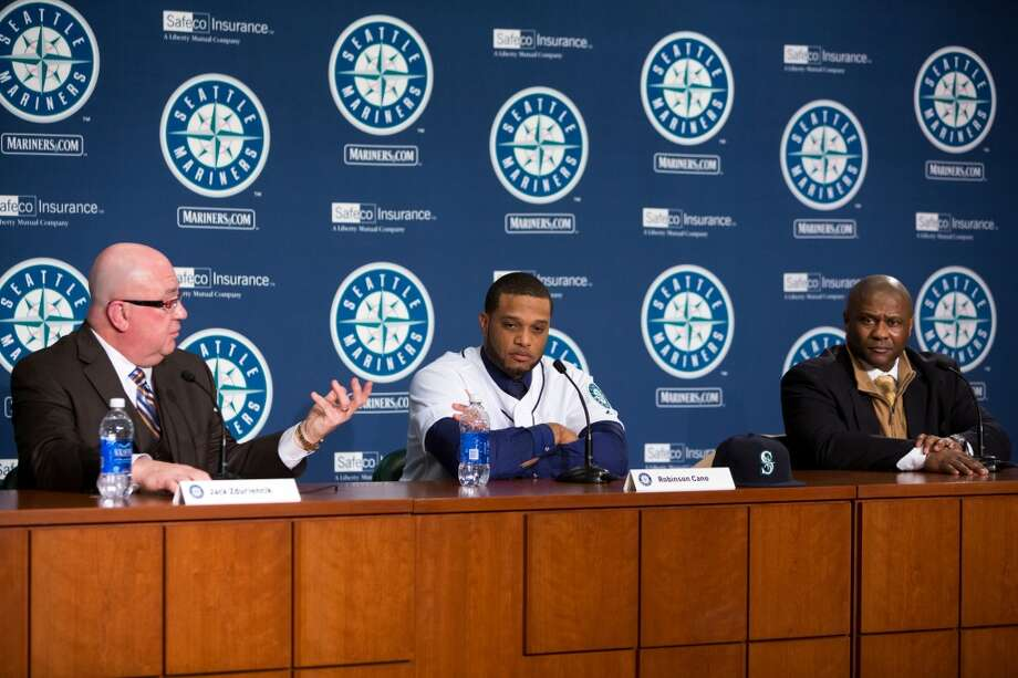 New Mariners second baseman Robinson Cano, center, speaks with Mariners manager Lloyd  McClendon, right, and general manager Jack Zduriencik, left, on Thursday, Dec. 12, 2013, at Safeco Field in Seattle. Cano is the biggest free-agent signing in the team's history. (Jordan Stead, seattlepi.com) Photo: JORDAN STEAD, SEATTLEPI.COM