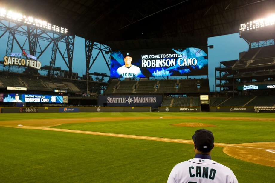 New Mariners second baseman Robinson Cano poses for pictures Thursday, Dec. 12, 2013, at Safeco Field in Seattle. Cano is the biggest free-agent signing in the team's history. (Jordan Stead, seattlepi.com) Photo: JORDAN STEAD, SEATTLEPI.COM