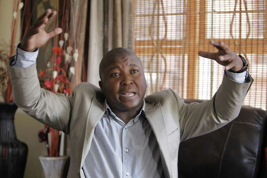 Thamsanqa Jantjie, who said he had been in a mental facility, insisted that he was doing proper sign-language interpretation of the speeches. Photo: Tsvangirayi Mukwazhi / Associated Press / AP