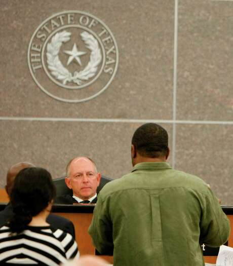 314th Court Judge John Phillips listens to case workers and attorneys reset a hearing date Thursday, April 10, 2008, in Houston. ( Nick de la Torre / Chronicle ) Photo: Nick De La Torre, Staff / Houston Chronicle