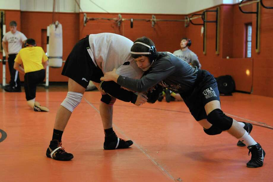 Albany Academy wrestler Matt Morris, right, and Sam Delarge  practice on Wednesday Dec. 11, 2013 in Albany, N.Y.  (Michael P. Farrell/Times Union) Photo: Michael P. Farrell / 00024990A
