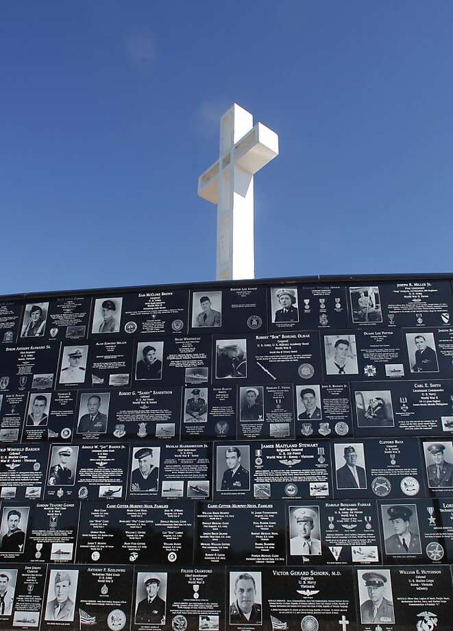Plaques honoring veterans line the walls around San Diego's Mount Soledad cross. Photo: Lenny Ignelzi, Associated Press