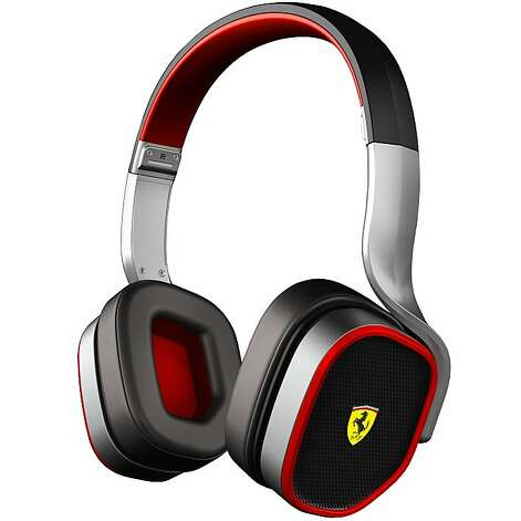 TECH TOYS: Ferrari's R200 headphones feature details inspired by the Scuderia Ferrari, which does not fold twice and store in its own case. $349, www.dsegnare.com Photo: Ferrari