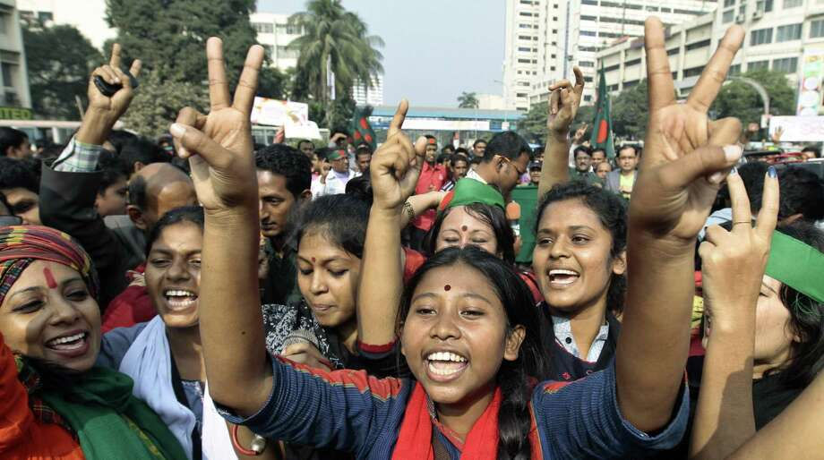 Social activists celebrate after the way was cleared for the execution of Abdul Quader Mollah. Photo: A.M. Ahad / Associated Press / AP