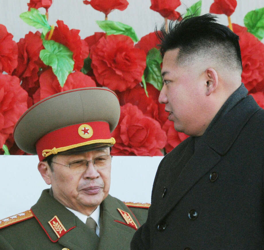 "North Korean leader Kim Jong Un walks past his uniformed Uncle Jang Song Thaek, who was described by the state news agency as ""worse than a dog."" Photo: Koyodo News / File Photo / Kyodo News"