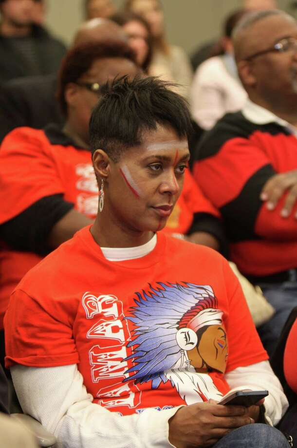 Carol Hoskins-Burks, a 1981 graduate from Lamar High School, attends an HISD board meeting on school mascots Thursday night. Hoskins-Burks opposes Lamar changing its mascot, which is currently called the Redskins. Photo: Gary Fountain, For The Chronicle / Copyright 2013 Gary Fountain.
