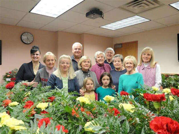 The Saratoga Hospital Volunteer Guild surprised patients and residents at Saratoga Hospital and Saratoga Hospital Nursing Home with a delivery of floral arrangements on Thanksgiving Day. The volunteers launched the tradition 10 years ago. They arrange hundreds of vases on Thanksgiving eve and deliver the flowers first thing the next morning. (Submitted by Betsy St.Pierre)