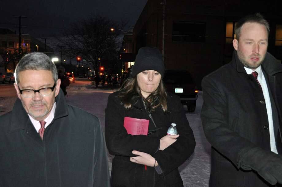 In this Tuesday, Dec. 10, 2013 photo, Jordan Graham, center, is flanked by defense attorneys Michael Donahoe, left, and Andy Nelson, as she leaves court in Missoula, Mont. Graham, the newlywed bride accused of deliberately pushing her husband to his death in Montana's Glacier National Park, agreed Thursday, Dec. 12, 2013 to plead guilty to second-degree murder. (AP Photo/Stephan Ferry) Photo: Stephan Ferry, FRE / AP