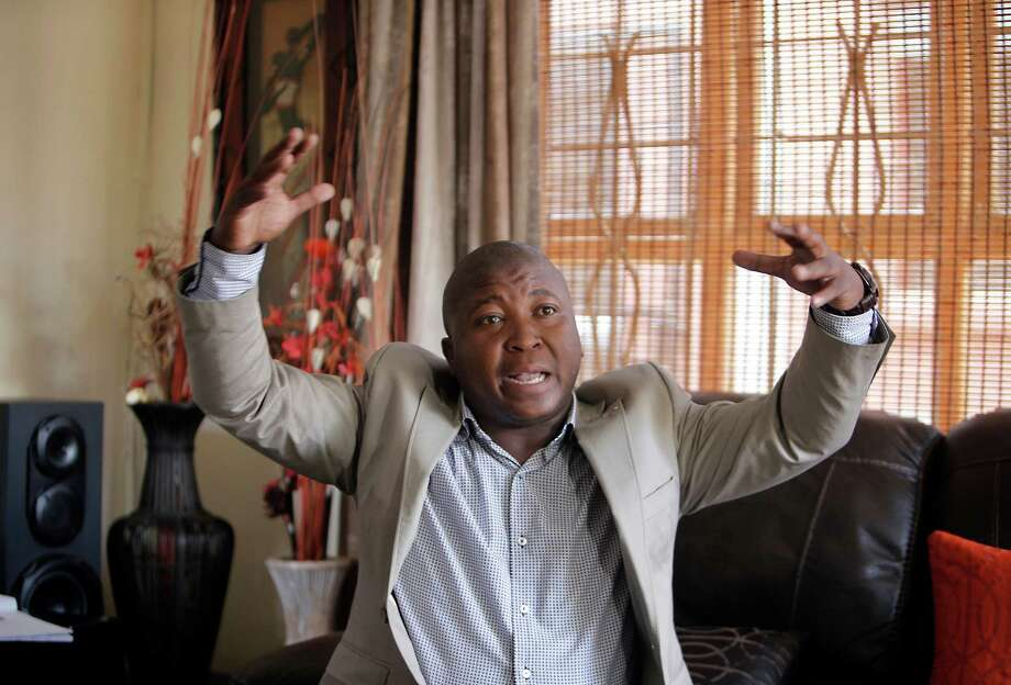 Thamsanqa Jantjie gesticulates at his home during an interview with the Associated Press in Johannesburg, South Africa,Thursday, Dec. 12, 2013. Jantjie, the man accused of faking sign interpretation next to world leaders at Nelson Mandela's memorial, told a local newspaper that he was hallucinating and hearing voices. (AP Photo/Tsvangirayi Mukwazhi) ORG XMIT: TH149 Photo: Tsvangirayi Mukwazhi / AP