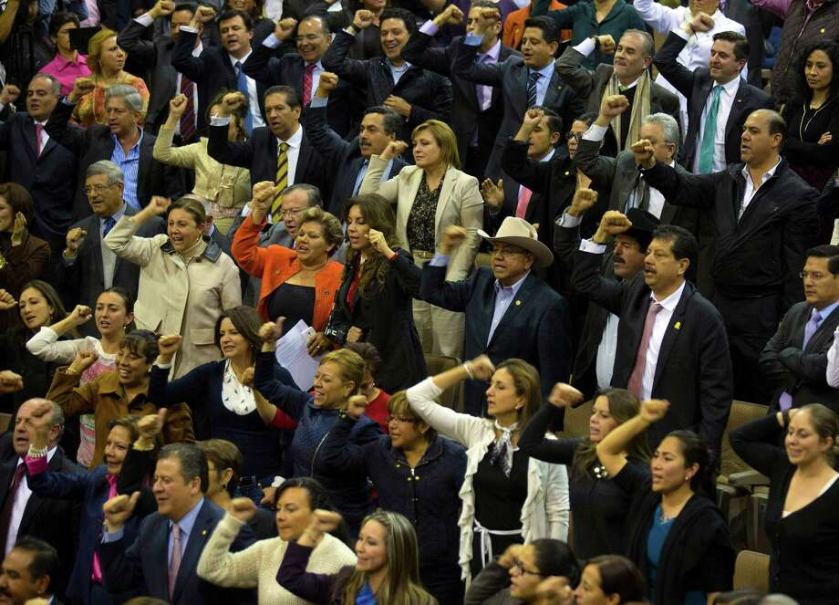 """Deputies cheer after the final vote for energy reform, shouting """"Mexico, Mexico,"""" on Thursday in Mexico's Congress. Photo: Susana Gonzalez / © 2013 Bloomberg Finance LP"""