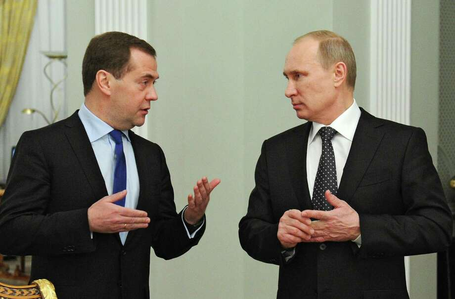 Russian President Vladimir Putin (right) shown with Prime Minister Dmitry Medvedev on Wednesday, said no country should think it can achieve military superiority over Russia. Photo: Mikhail Klimentyev / Associated Press / RIA Novosti Kremlin