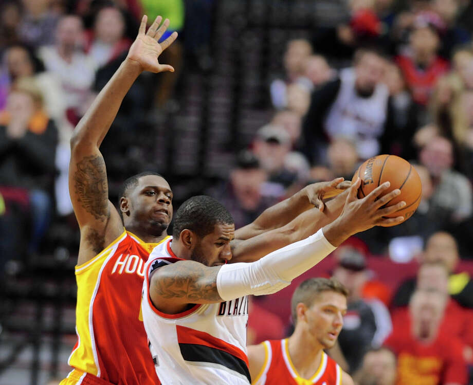 As has been common since Omer Asik's injury, the Rockets' Terrence Jones, left, drew the tough assignment Thursday in Portland's LaMarcus Aldridge. Photo: Greg Wahl-Stephens, FRE / FR29287 AP