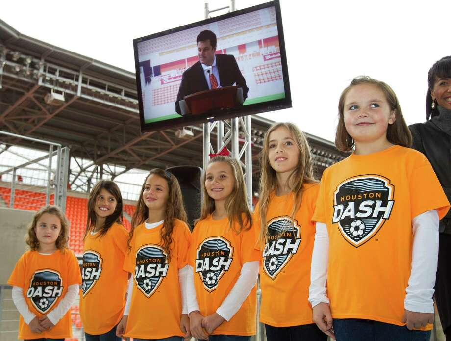 Dynamo president Chris Canetti, shown on a video monitor at BBVA Compass Stadium on Thursday, announces the launch of the Houston Dash - the newest team in the National Women's Soccer League. The Dash, who will be owned and operated by the Dynamo, will begin play in the nine-team league in the spring. Photo: Brett Coomer, Staff / © 2013 Houston Chronicle