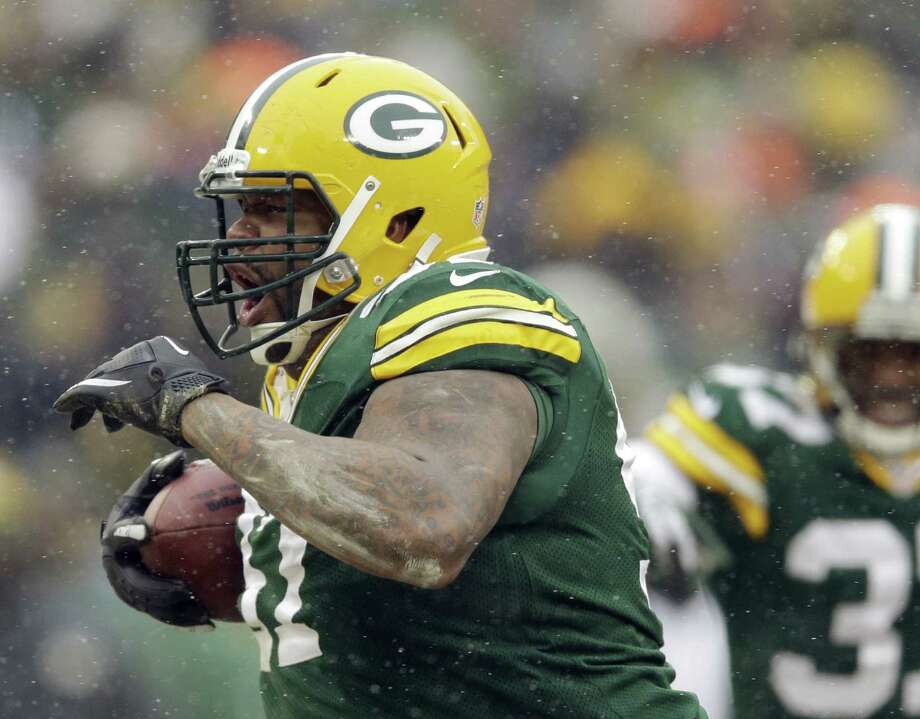 Texas A&M product Johnny Jolly, celebrating during the Packers' victory over the Falcons, has turned his life and career around after serving six months in prison on drug charges. Photo: Tom Lynn / Associated Press / FR170717 AP
