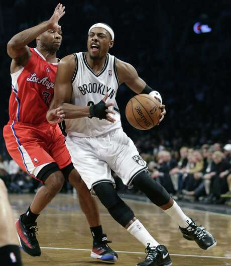 Brooklyn veteran swingman Paul Pierce (right), driving against Los Angeles guard Willie Green, had 10 points off the bench in Thursday's win. Photo: Kathy Willens / Associated Press / AP
